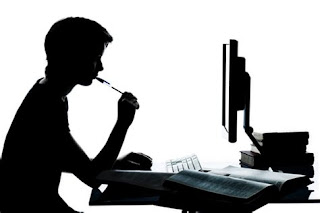 A writer at his desk making money online using his writing skills