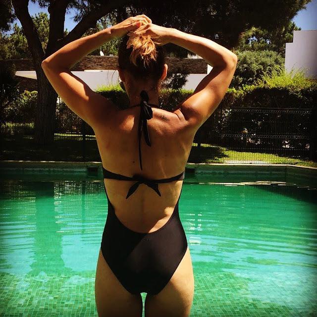 Joana Teles in swimsuit at beach villa
