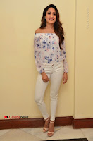 Actress Pragya Jaiswal Latest Pos in White Denim Jeans at Nakshatram Movie Teaser Launch  0008.JPG