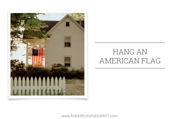 Hang an American flag from your porch to make it more welcoming.