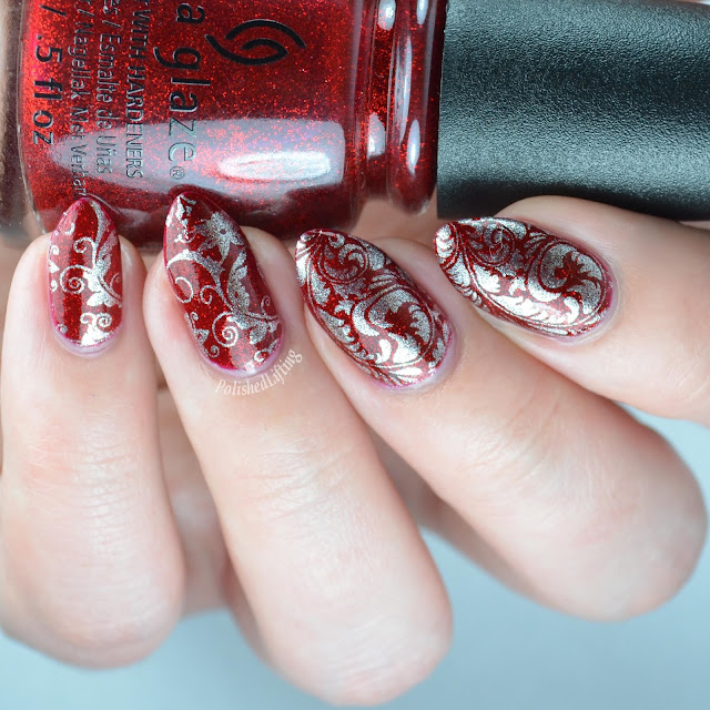 red glitter nail polish with stamping
