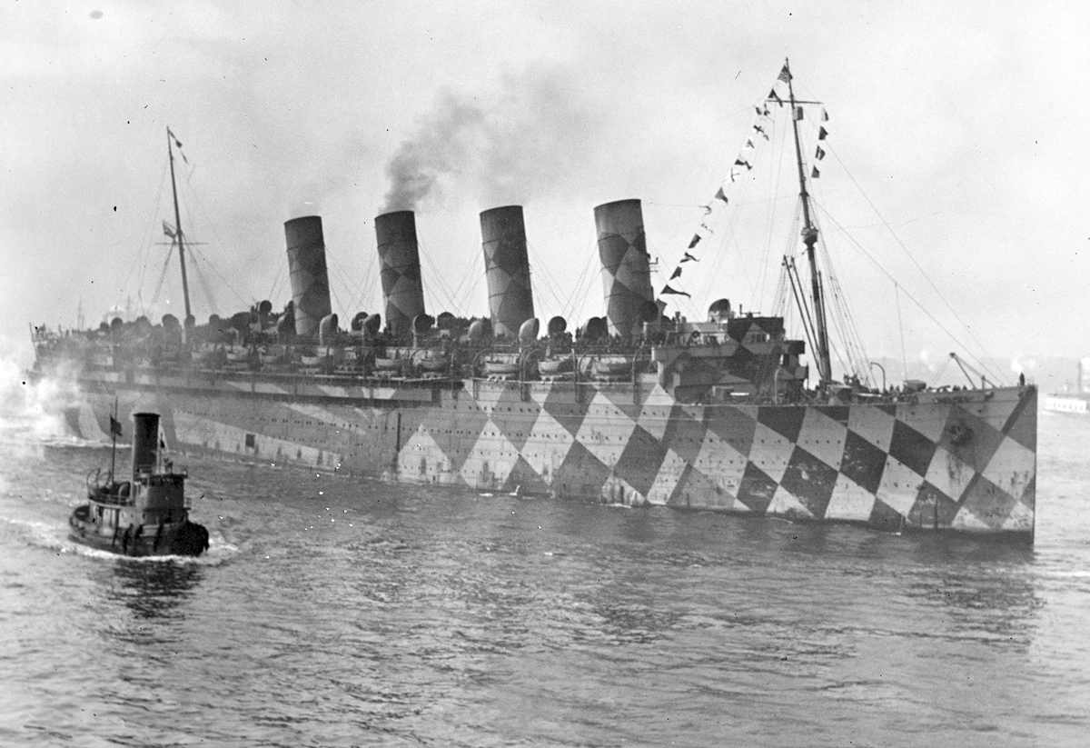 The RMS Mauretania in an American port with dazzle camouflage.