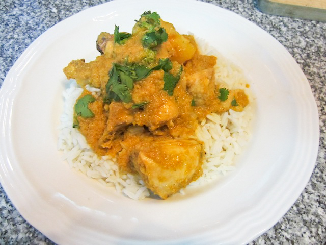 Food Lust People Love: Burmese Chicken Curry begins with a fragrant cayenne spiked curry paste made onions, garlic and ginger. Cinnamon sticks are added while the chicken slowly simmers. The delightful aroma is  will bring the family into the kitchen to see what's cooking!