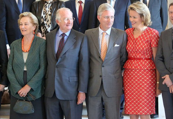 Members of the Belgian Royal Family hosted a reception at the Royal Castle in Laeken. wore this peplum belted and printed dress