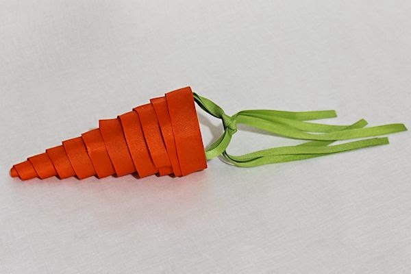 http://aboutfamilycrafts.com/candy-carrot-cone-craft/
