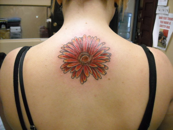 daisy chain tattoo on back of neck
