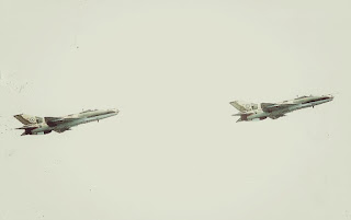 Two Nigerian Air Force F-7 Air Guard undertaking an aerial maneuver