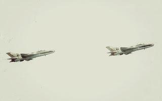 Two Nigerian Air Force F-7 Air Guard undertaking an aerial maneuver