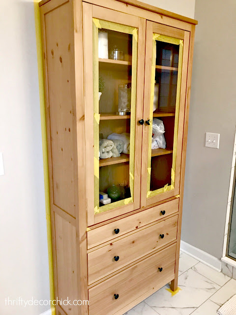 Wood IKEA cabinet with drawers and glass doors