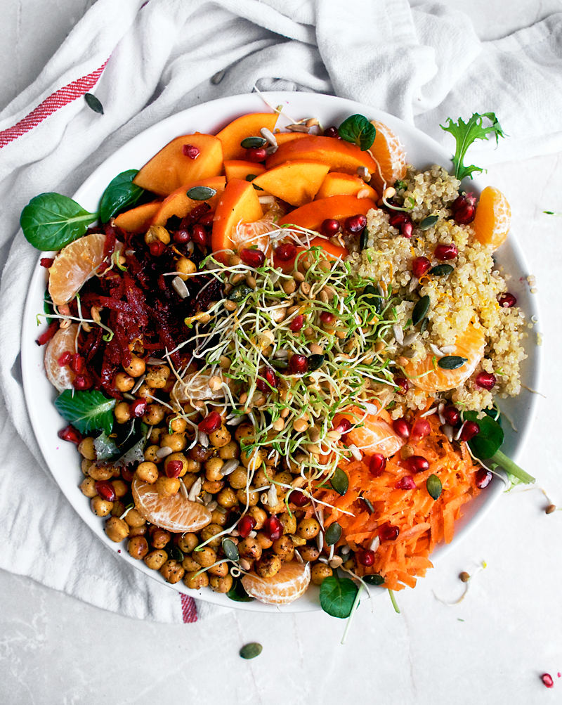 This winter grain bowl is packed with seasonal produce - beets, carrots, persimmon, mandarin, and pomegranate, alongside quinoa and greens. Topped with an orange ginger dressing for a fresh cold weather lunch or light dinner.