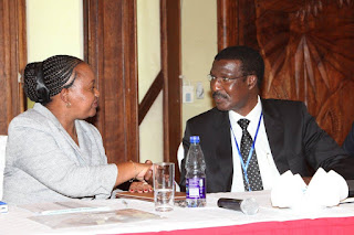 Anne Waiguru, Cabinet Secretary for Devolution and Planning receives a warm handshake from Kenya Power MD&CEO Dr. Ben Chumo during the County Governors Forum. PHOTO | Courtesy