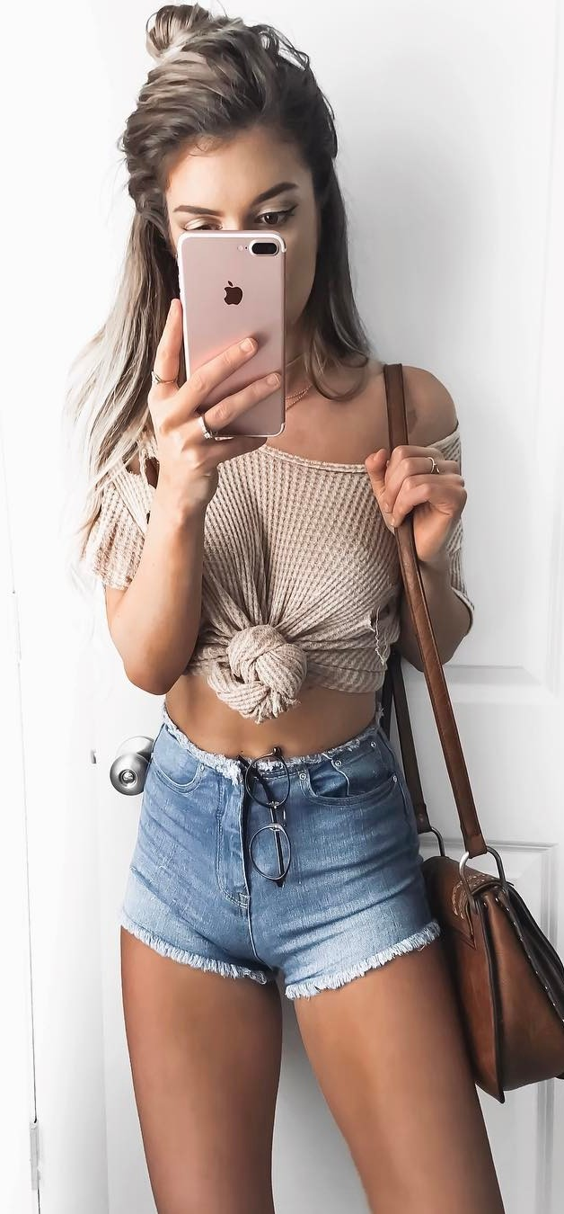 cute street style outfit: crop top + shorts + bag