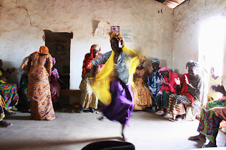 Tostan CEP Participants in Tambasansang, The Gambia put class topics to lyrics and dance