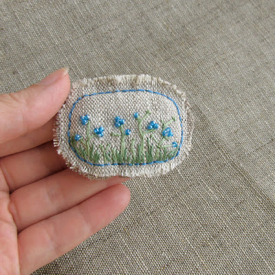 blue flowers brooch
