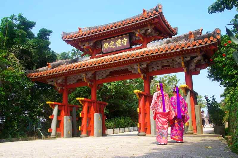 Shuri Castle Gate with two kimono clad women