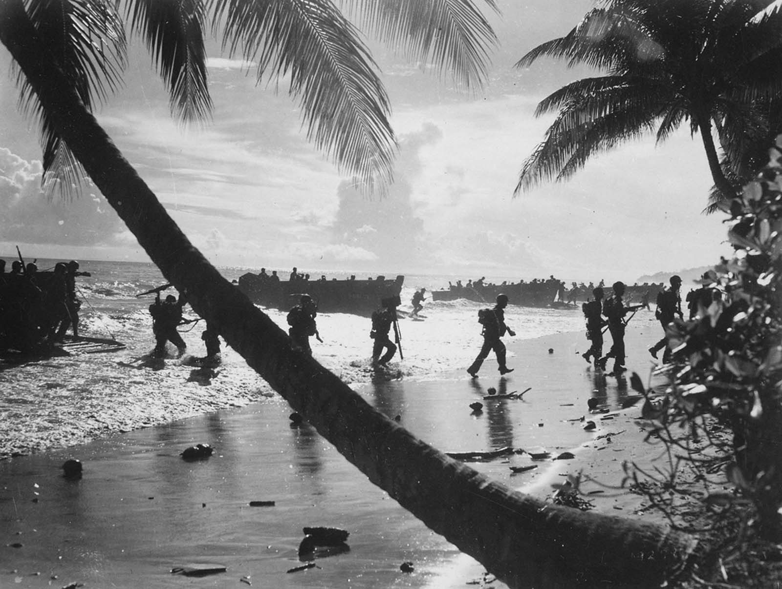 U.S. troops from the 160th Infantry Regiment are seen as they disembark from a landing craft during amphibious training on Guadalcanal, Solomon Islands, in August of 1942.