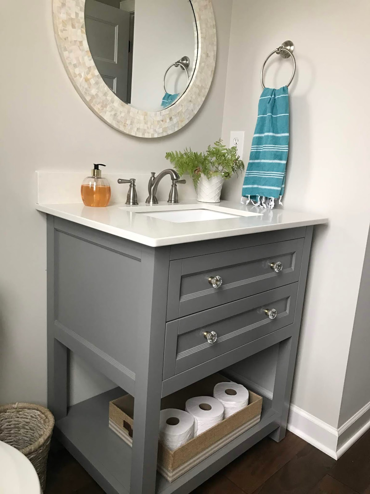 Light gray bathroom vanity with drawers