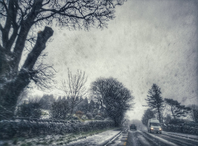 image taken while in the car, snowing heavily