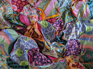Wonderwall curved quilt by Charm About You with Conservatory fabrics, featured in Love Patchwork and Quilting