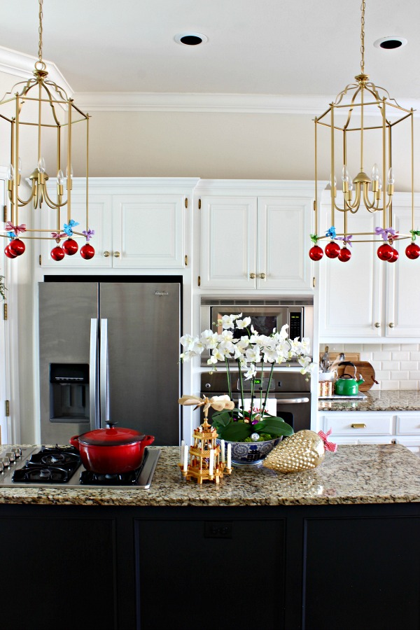 gold lanterns, black and white kitchen
