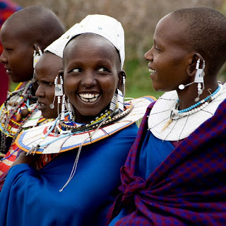 Maasai villagers in traditional clothing and jewelry in the Serengeti National Park, Tanzania