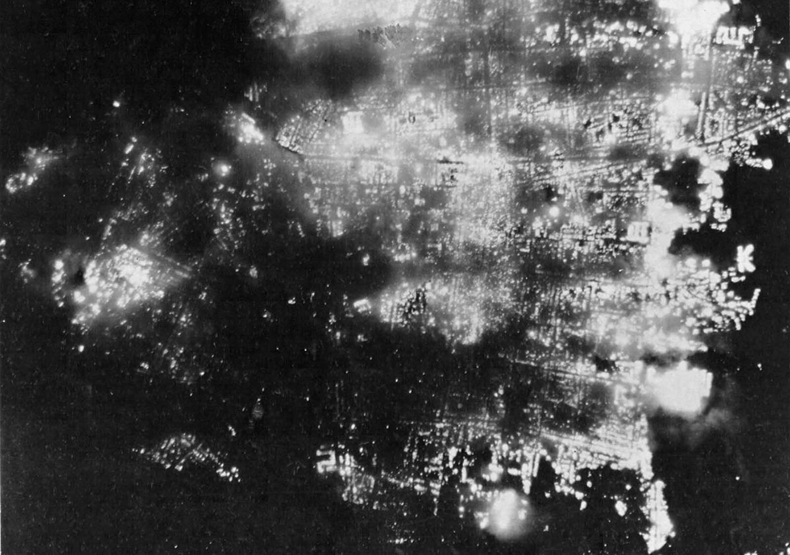 A night view of burning Toyama, Japan on August 1, 1945, after 173 American B-29 bombers dropped incendiary bombs on the city. Formerly a big producer of aluminum, the city was 95.6% demolished.