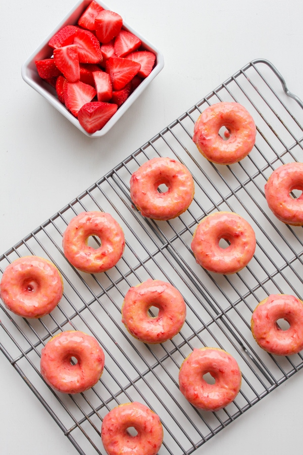 These cardamom donuts are light and fluffy, baked not fried, and topped with a simple and sweet strawberry frosting. They are perfect for spring!