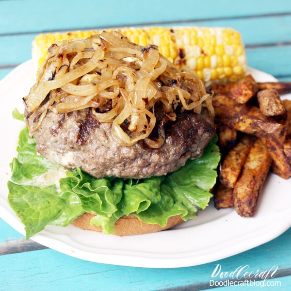 Thick hamburger stuffed with blue cheese crumbles topped with sauteed onions served with french fries and grilled corn.