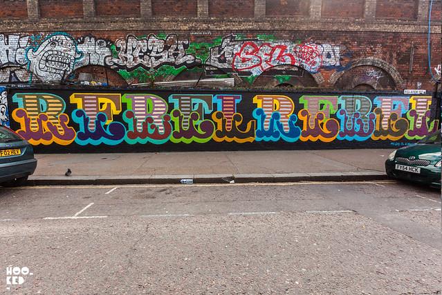 Shoreditch street art mural painted by London artist Ben Eine
