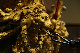 Lion detail on Gold State Coach at the Royal Mews, Buckingham Palace