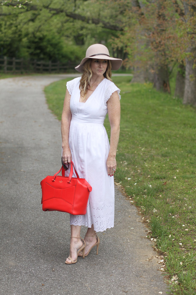 floppy hat, white dress, red tote bag
