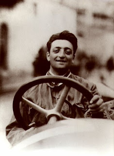 A young Enzo Ferrari pictured at the  wheel of a racing car