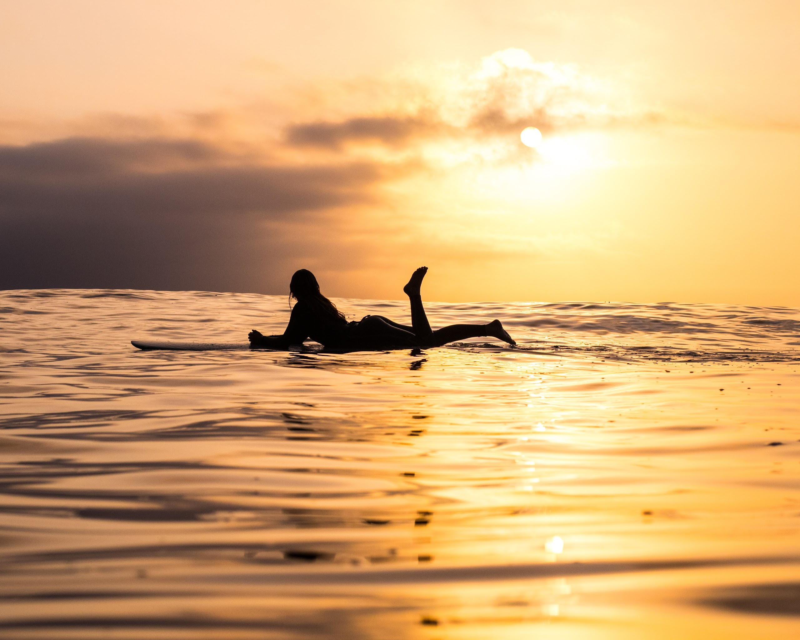 Girl On Surfing Board The Sea In Sunset