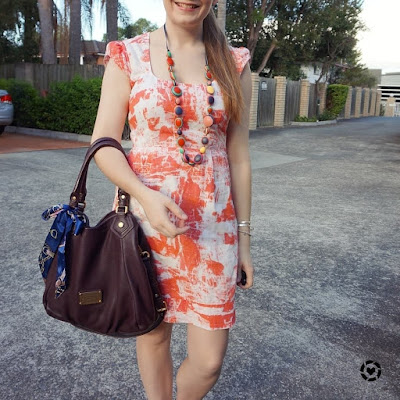 awayfromblue instagram | orange printed french connection sheath dress colourful statement necklace marc jacobs fran bag