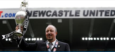 Rafa Benitez holding up Newcastle United's Championship winners cup in St. James' Park