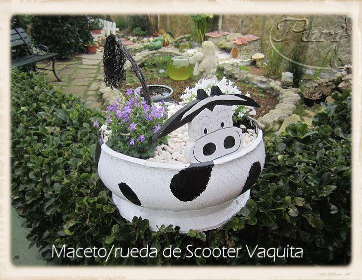 Manualidades puri diaz maceta con rueda de scooter vaquita for Vacas decorativas para jardin