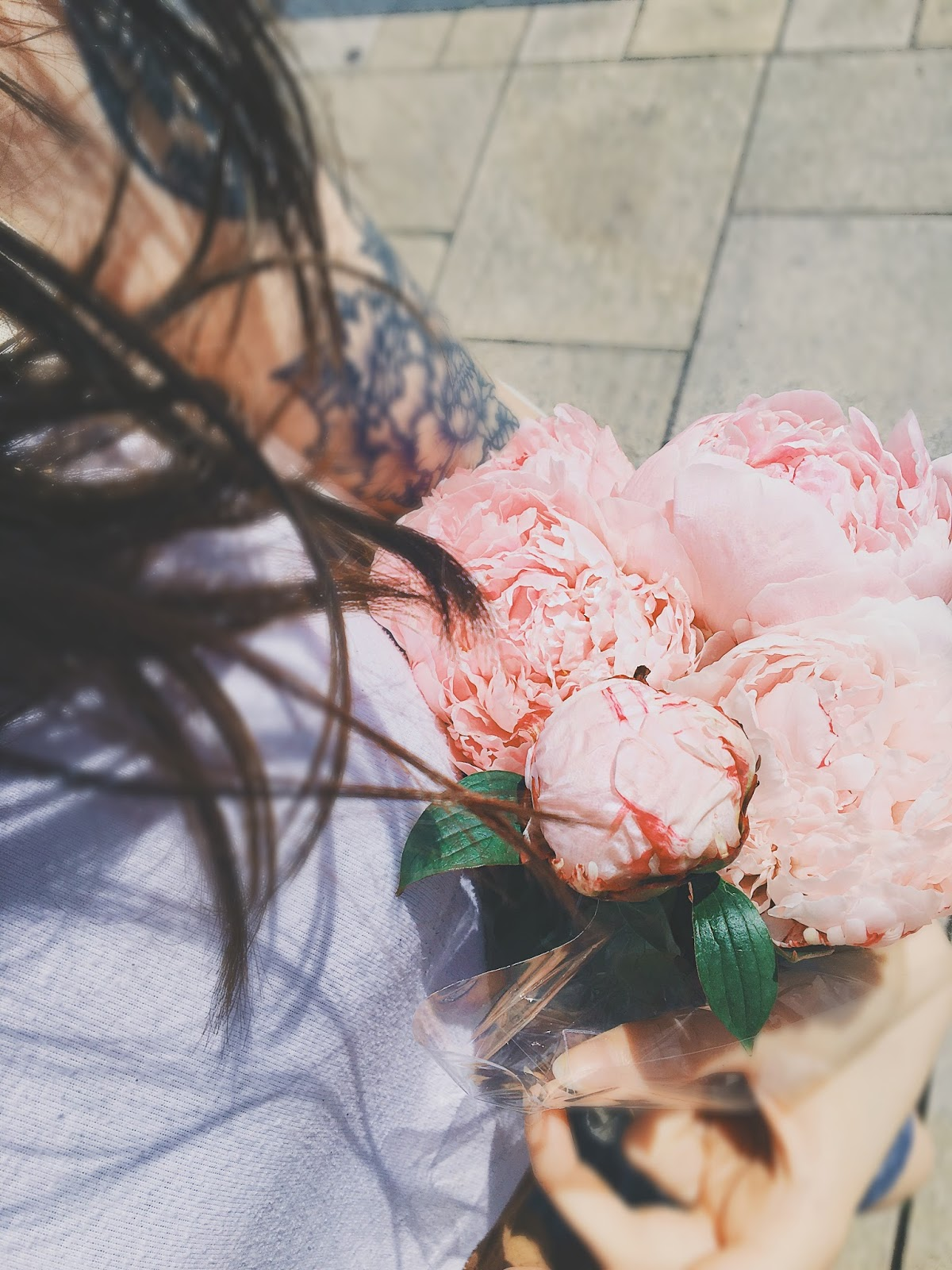 girl carrying pink peonies