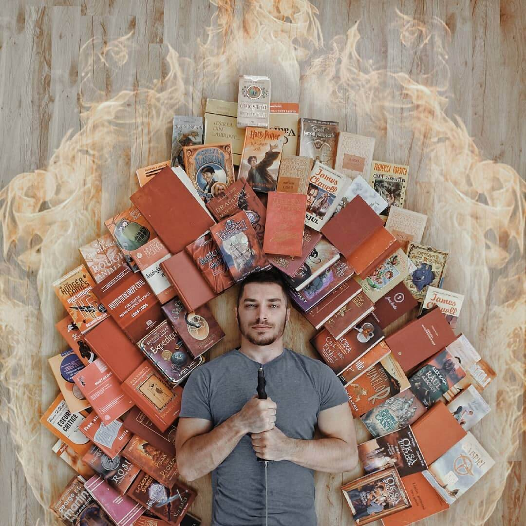 Guy Creatively Arranges His Huge Library of Books Into Artistic Scenes