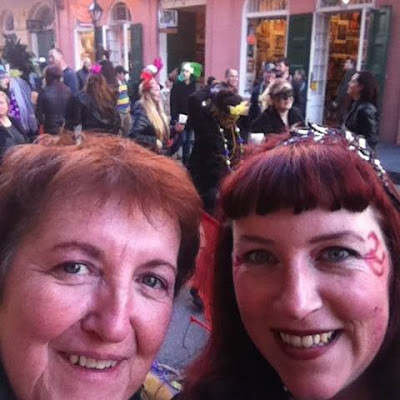 Bridget Eileen and mom on Decatur St in French Quarter, Mardi Gras Day 2015