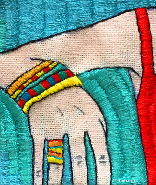 Broderie : femme aux bracelets