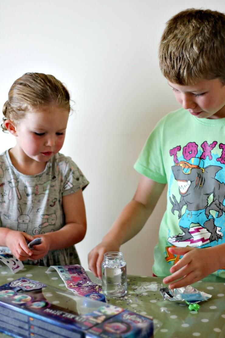 Kids decorating So Glow DIY Magic Jars