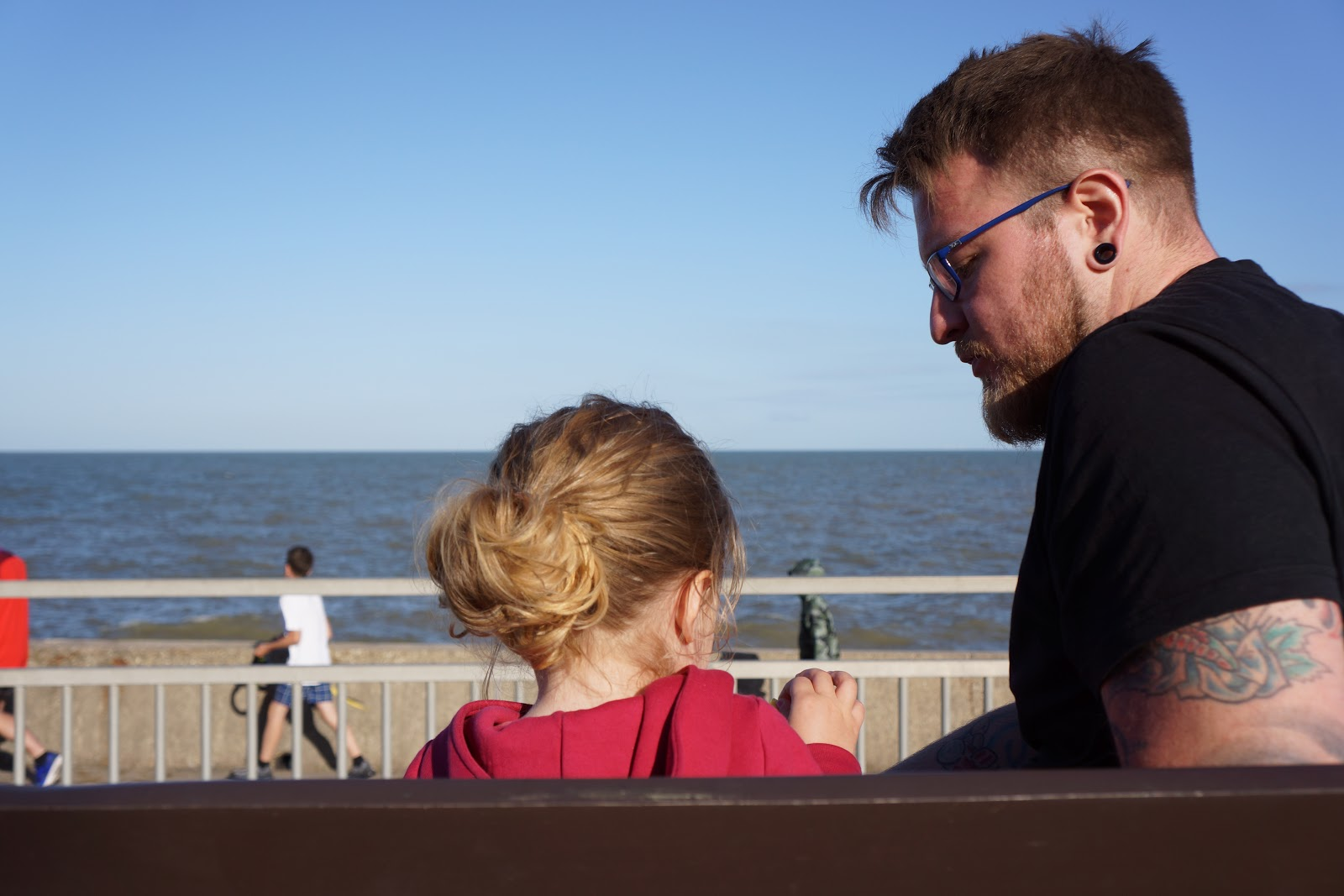 dad and daughter by the seaside