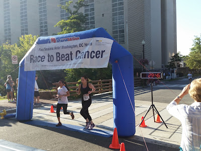 Two runners at the finish of the 2017 Race to Beat Cancer 5K