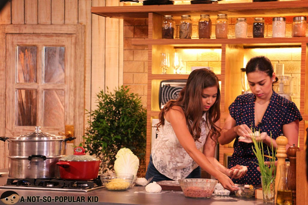 Louise Delos Reyes and Bettinna Carlos preparing the Toasted Siopao