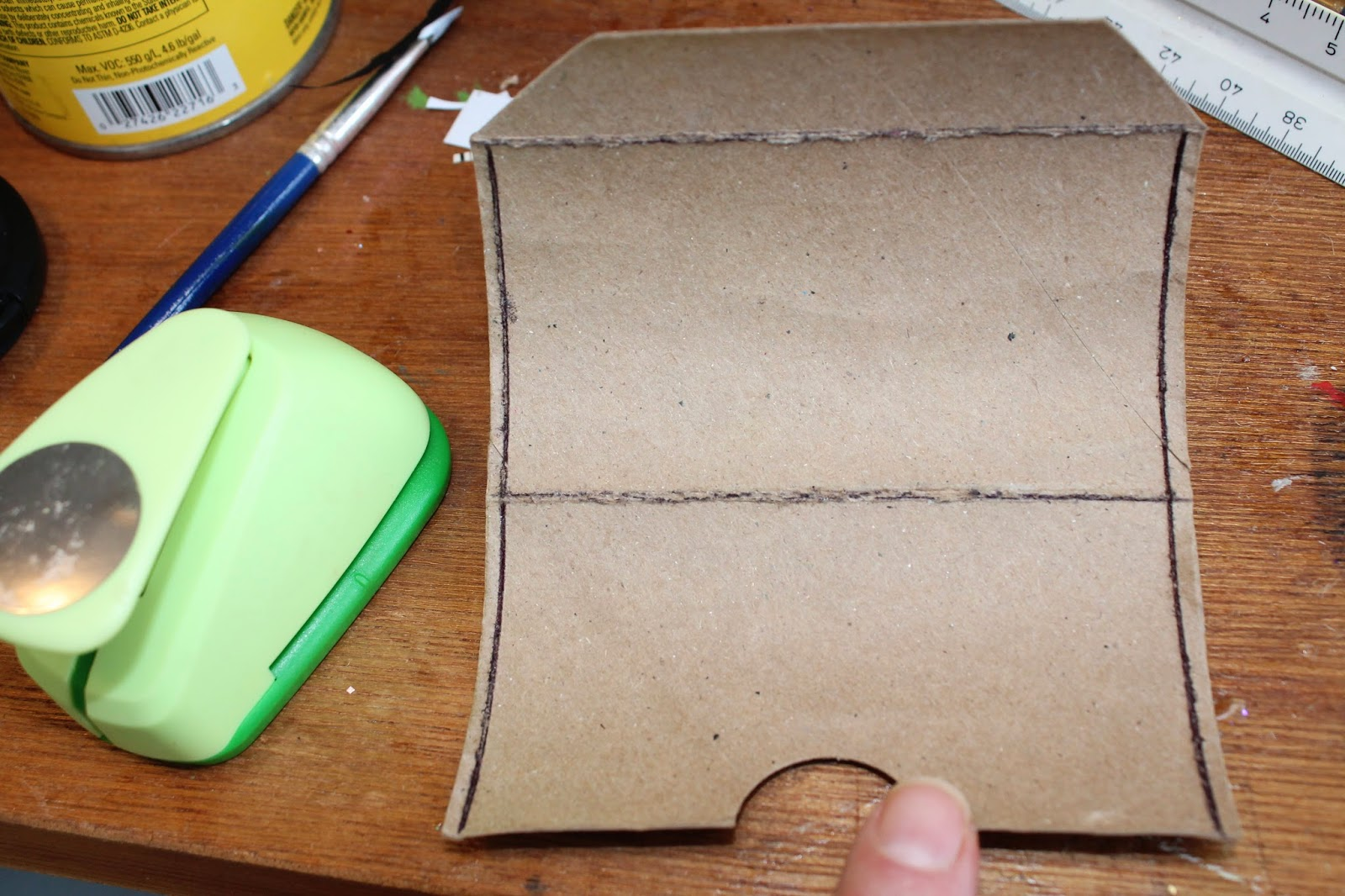 upcycled toilet paper tube becomes a business card holder