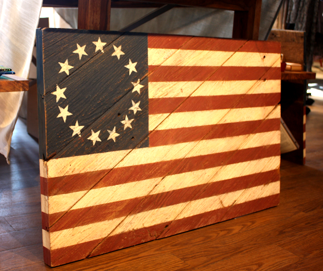 History becomes art as Marie Roth combines wood salvaged from old barns and historic flags found at Epilogue in Long Grove, Illinois.