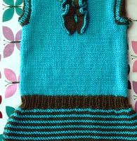 http://www.ravelry.com/patterns/library/tuxita-baby-tunic