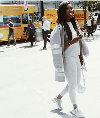 Tiwa Savage stuns in white and black outfit