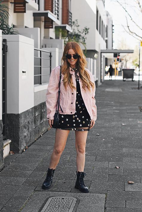 Kiara King, pink denim jacket, sequin mesh dress, Fendi Arrow Accent Sunglasses, Status Anxiety bag, lace-up combat boots