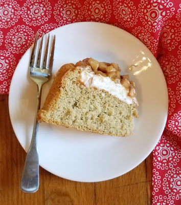slice of cinnamon sponge charlotte cake with caramel apples on plate with fork